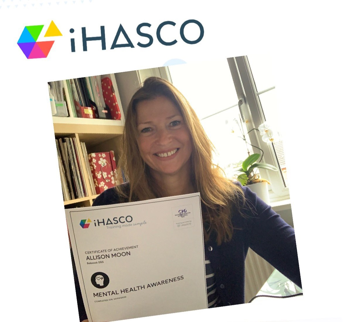 A learner holding their iHASCO eLearning certificate for the #iHASCOCompetition