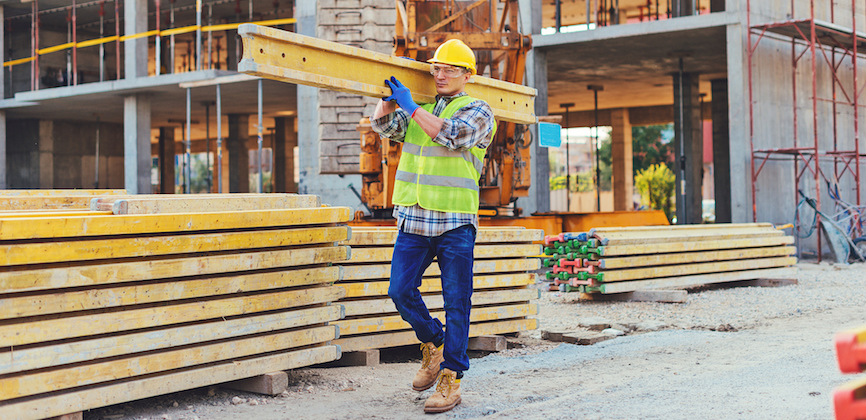 Man carrying steel beam as part of LOLER