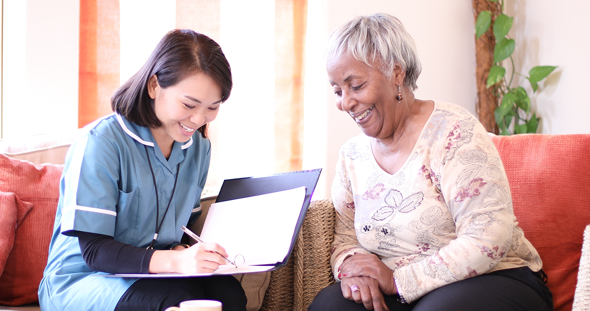 A carer speaking to a resident - A screenshot from one of our care certificate courses