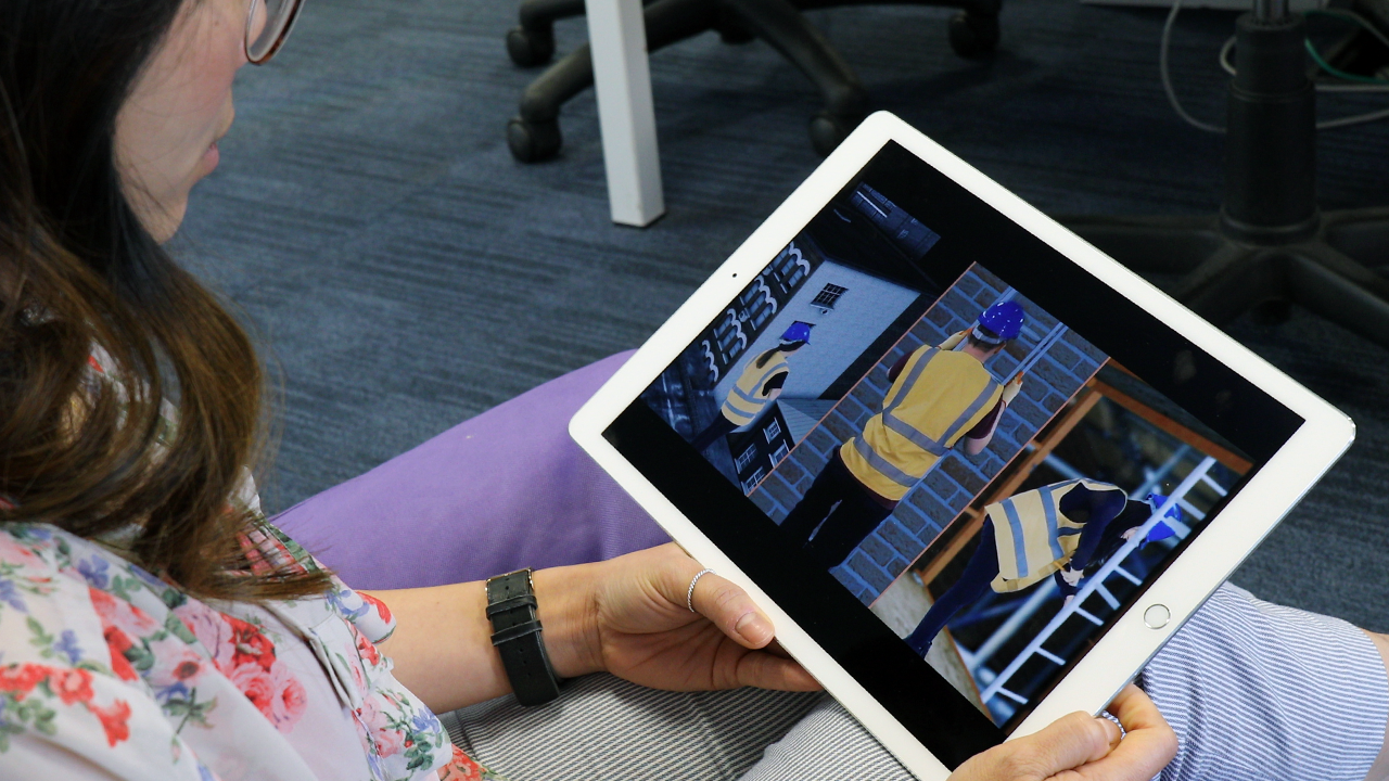 Person completing iHASCO training on iPAD
