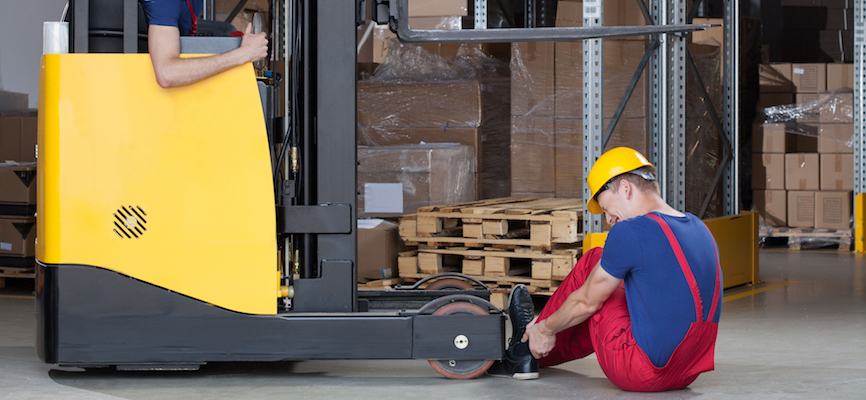Avoiding injuries from moving vehicles in a warehouse