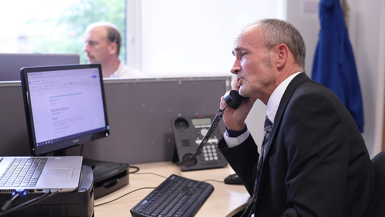 Man on the phone in a workplace