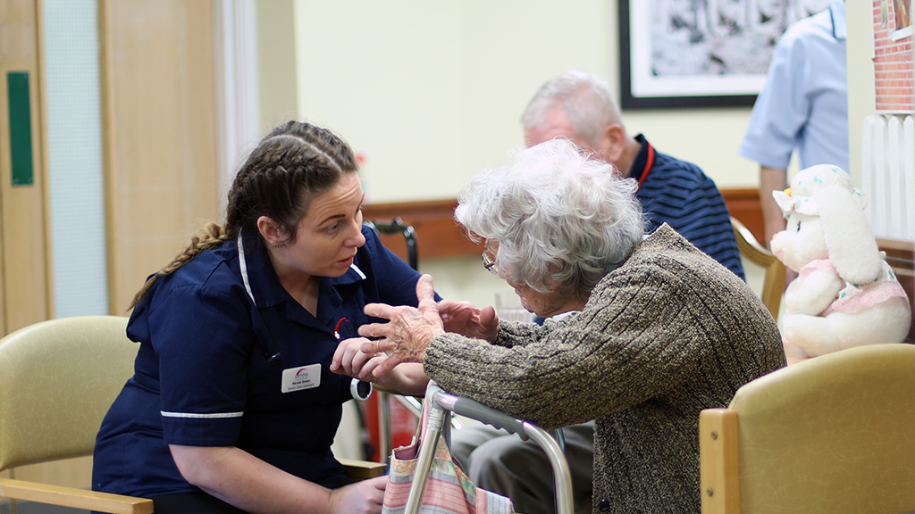 A carer talking to a patient