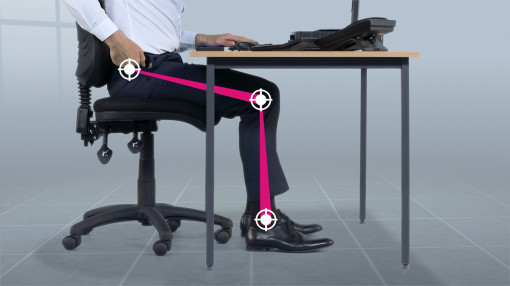 Showing how to correctly sit at a desk