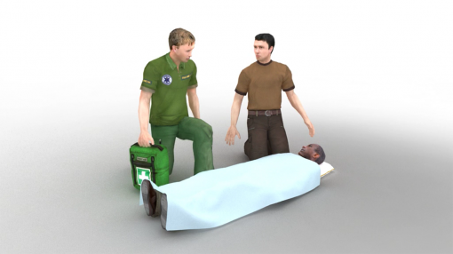 First aid appointed person in the workplace beside an employee on the floor as part of our first aid appointed person training