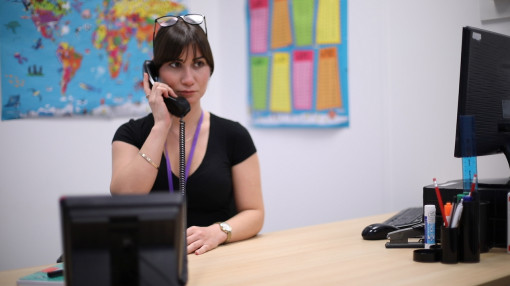 School teacher on the phone looking concerned