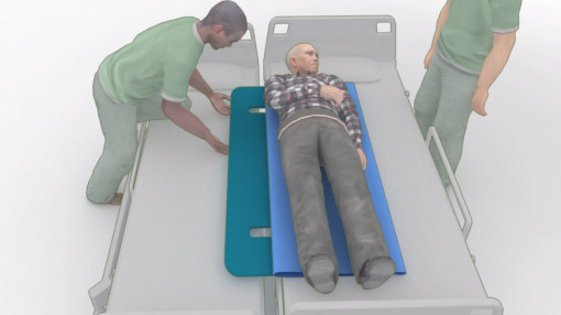 A man preparing to lift another from a hospital bed as part of moving and handling people training