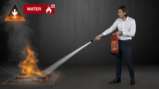 Our presenter using a fire extinguisher