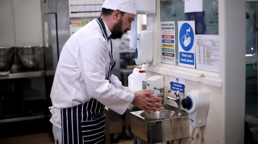 A chef washing his hands