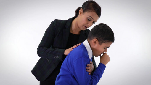 A child choking and receiving back blows