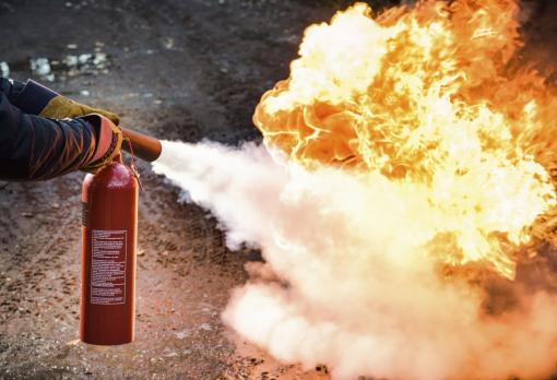 A fire extinguisher in use - Fire Warden Training