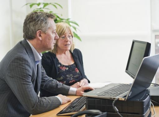 Colleagues around a computer - Health and Safety Training for Managers & Supervisors