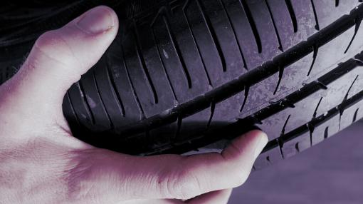 a hand holding a tyre - Manual Handling inc Tyres Training