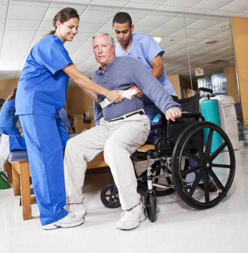 Man sitting in a wheelchair - Moving and Handling People Training