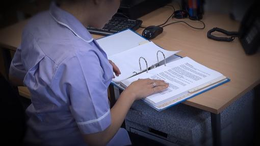 Someone reading through their training - Personal Development in Care Training