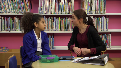 A student and teacher talking