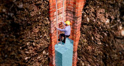 A person entering a man hole - Confined Space Training