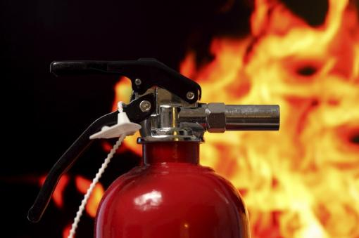A close-up of a fire extinguisher - Fire Warden Training in Construction