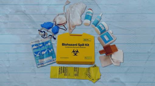 Someone apply their PPE from their spill kit - Spill Kit Training: Bodily Fluids